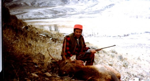 My father with his recently shot elk.