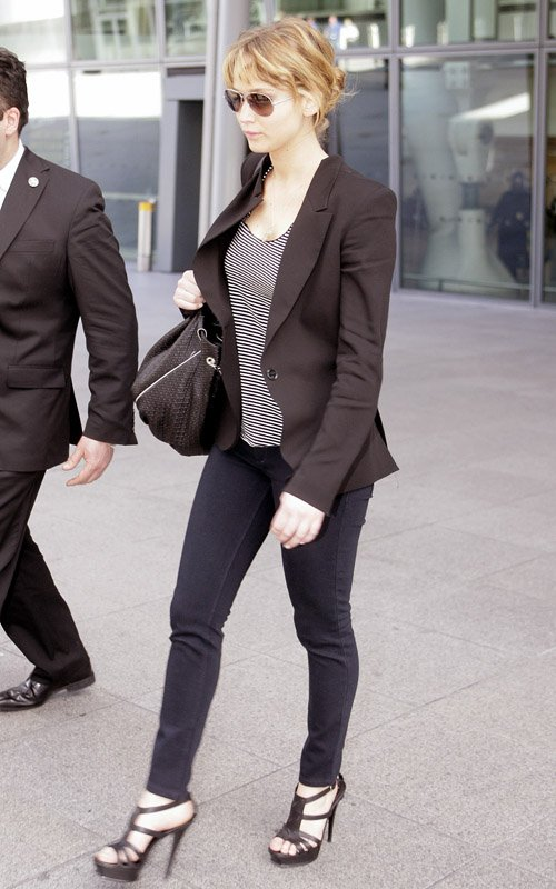 Jennifer Lawrence in tight jeans and strappy heels
