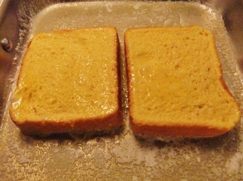In a rectangular skillet you can easily cook two to four slices at a time.  Don't be impatient.  Check the browning process by lifting a corner of the bread to see underneath.