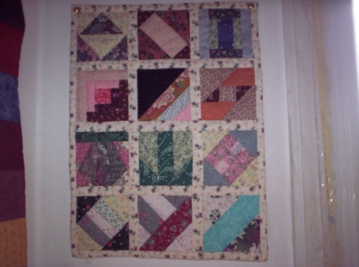 One of the first miniature quilts I made. I was commissioned to make one with the same patterns but with solid colors and black.