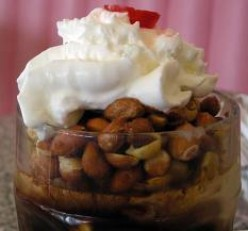 Soft serve ice cream Tin Roof Sundae with whipped cream and a cherry for me.  How about you?