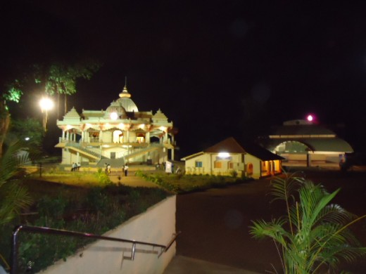 The house( center) and the Universal temple built in 2004(left side)At the rear side, the auditorium is seen.