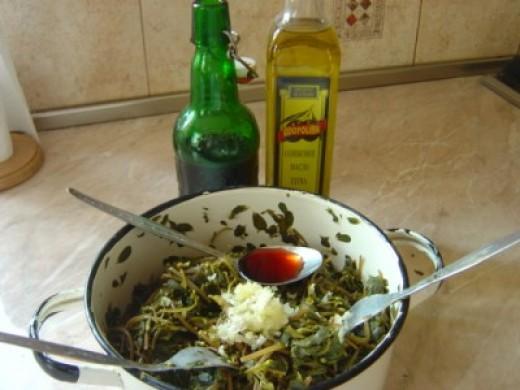 Add salt, minced garlic, oil and vinegar