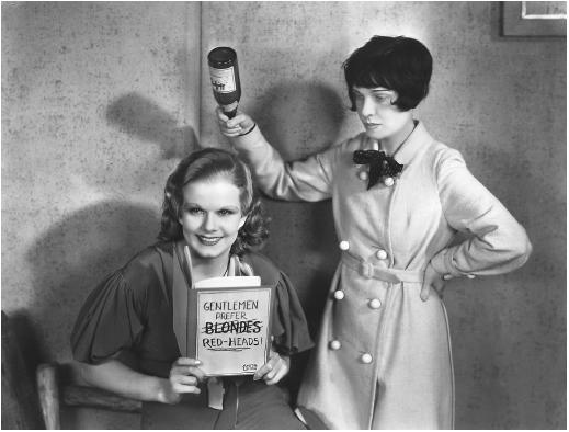 Jean Harlow reading Gentlemen Prefer Blondes, and being watched by the brunette author Anita Loos