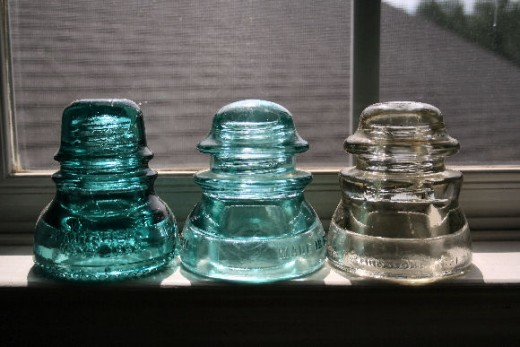 Three glass insulators.