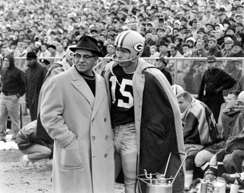 'Vince Lombardi and Bart Starr talk strategy.'