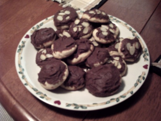8.  Chocolate Spritz cookies, some with Almond slivers on top
