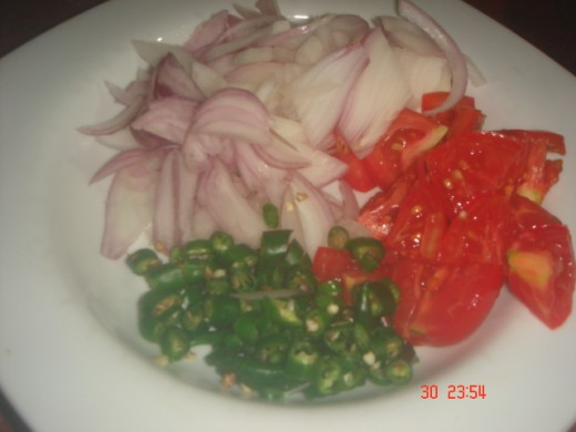Chop some onion, green chili and tomato