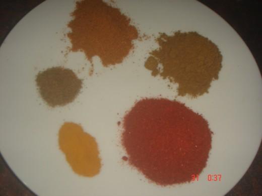 spice powder.top clockwise. garam masala, coriander powder, chili powder, turmeric powder and cumin powder