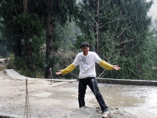 my son enjoing the rain at Manali-Himanchal Pradesh, India