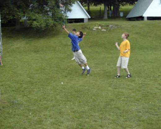 kids playing backyard football kids playing badminton
