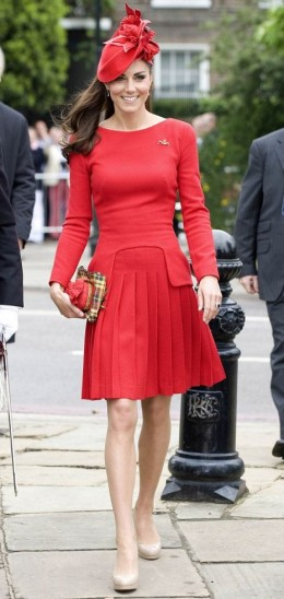 Kate's red dress is designed by Sarah Burton for Alexander McQueen