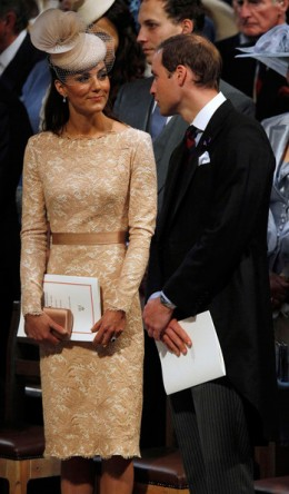 Kate in Alexander McQueen outfit attending a service of thanksgiving to mark the Queen's Jubilee. She is waiting with her husband, Prince William at the start of the service.