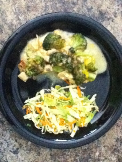 A portion of chicken and broccoli casserole served with vinagrette coleslaw.