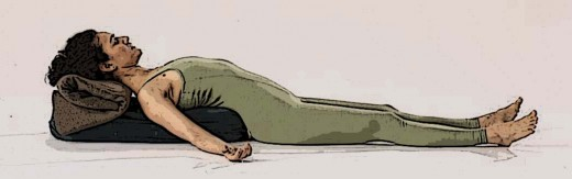 Savasana - corpse pose, supported by blankets or a bolster