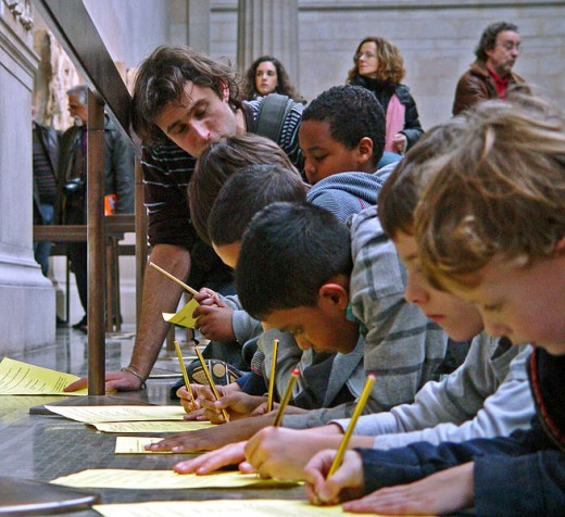 A teacher and young pupils at The British Museum Duveen Gallery.
