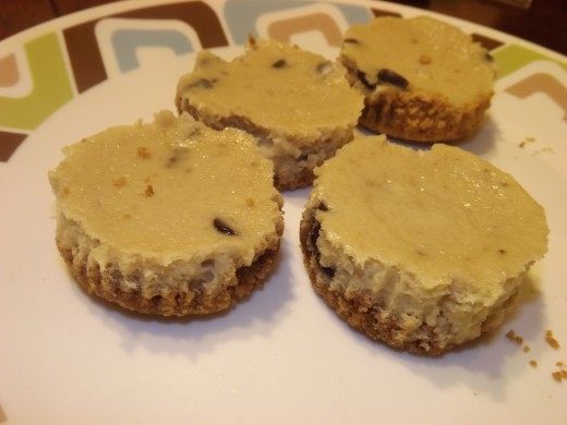 Finished and ready to eat mini banana chocolate chip cheesecakes.