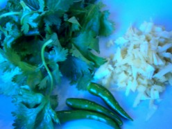 Chopped garlic and ginger, cilantro, mint and green chilies add flavor and spice.