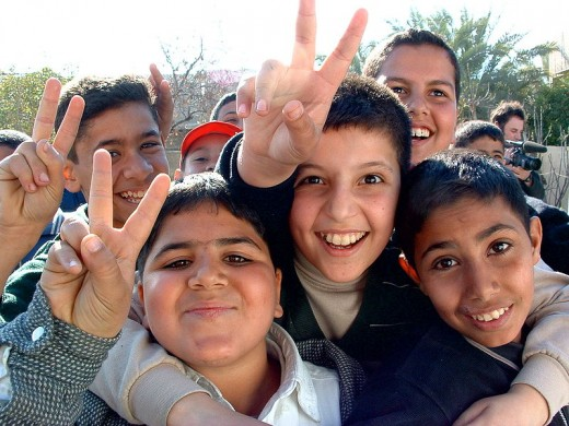 Boys from Iraq smiling and giving peace signs to the photographer. Makes me more optimistic for the future.