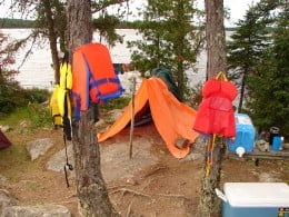 One of our 'sauna tents'.  The rocks on the outside hold the sides down.  The ends were later closed with an extra smaller tarp.
