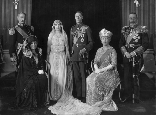 The wedding. On the left are Lady Elizabeth's parents, the Earl and Lady Strathmore. On the right are the Duke's parents, King George V and Queen Mary.