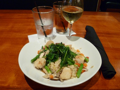 Delicious scallops with broccoli rabe and other vegetables is a healthy choice for a seafood dish.