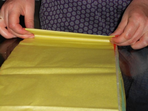 Turn over tissue and fold back