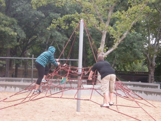 Some playgrounds have Spider Man-like equipment to climb - even the teenagers enjoy the challenge.