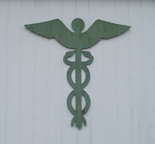 Have always wondered about the snakes crawling up the cross for the medical symbol.