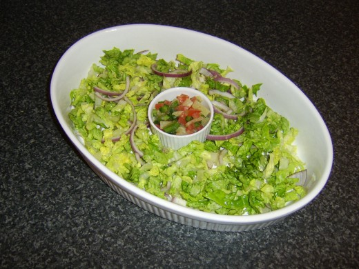 Salsa is added to the salad