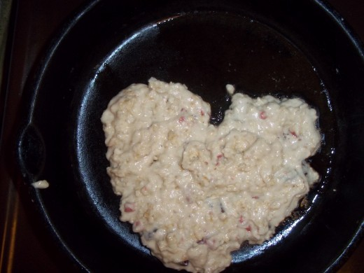 Heart shaped pan cookie in hot skillet