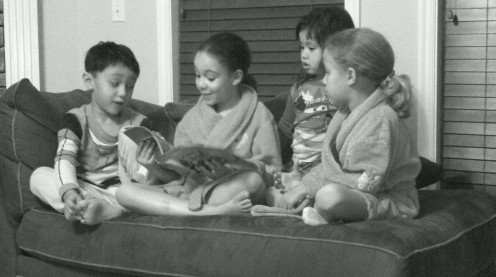 My oldest daughter reading a bedtime story to her sister and cousins.