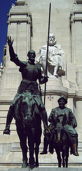 Statues of characters, Don Quijote and Sancho Panza with Miguel Cervantes looking on, in the Plaza de Espana, in Madrid, Spain.