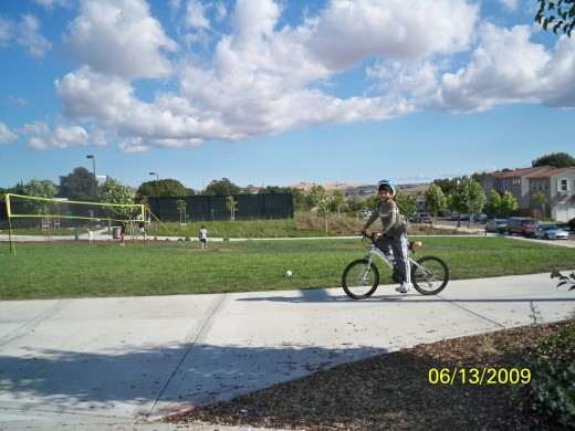 Kid Biking in A Park