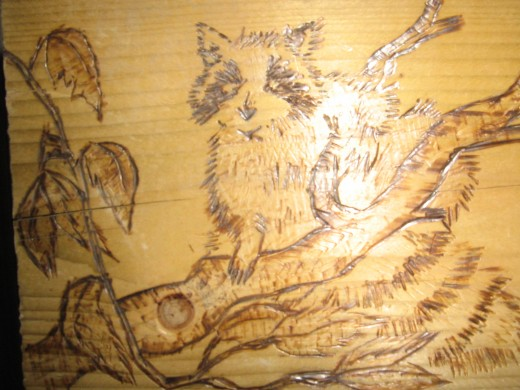 artwork burned into wood using soldering iron