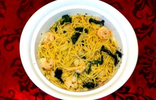 Our finished dish full of delicious shrimp pasta with sauteed spinach.