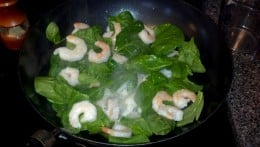 Add the shrimp and spinach to the pan.