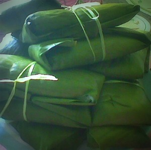 suman wrapped in banana leaves