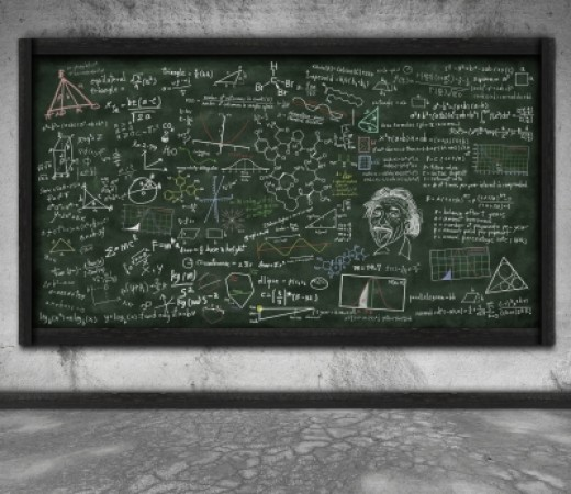 A chalkboard with physics equations and doodles.