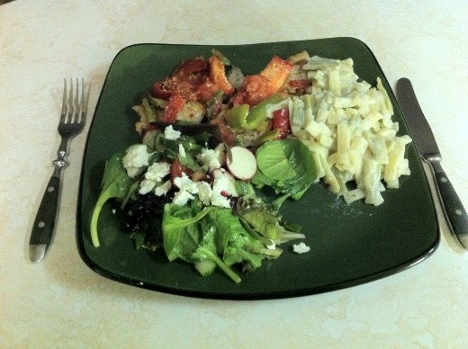 Pork loin chops with a vegetable topping,Spring salad, and fettuccine  pasta.
