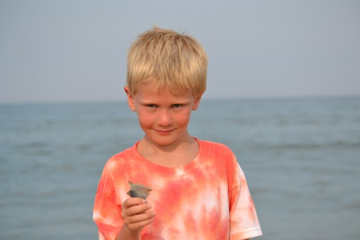 My son showing me one of his entries into the best shell category