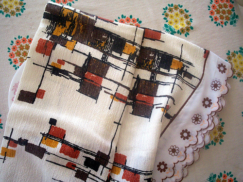 This homemade tablecloth is actually a piece of atomic barkcloth. Take off the trim or sell as is.