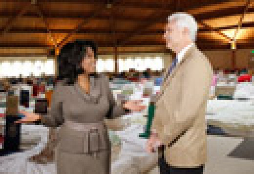 Oprah talking to Mayor Ed Malloy, the mayor of Fairfield, IA, himself a TM meditator, in the Men's Dome.