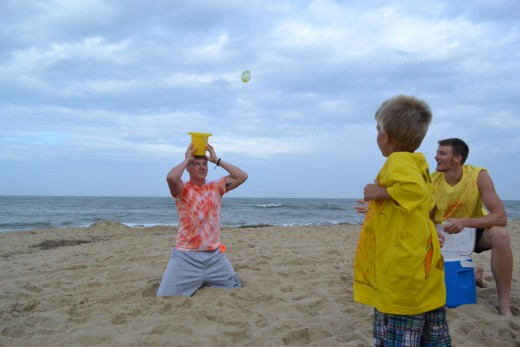 Balloon water balloon toss in bucket