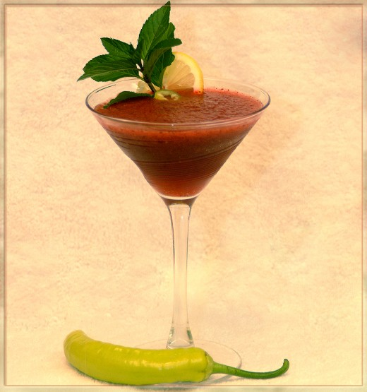 A spirited cocktail using Malibu rum, fresh fruit, and spicy chilli pepper which brings a crisp cool heated sock in the chops!