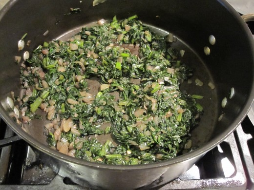 The greens will reduce substantially in volume as they cook.