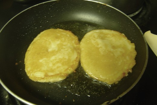 The Akara (pancake style) during the frying process. Images are by ComfortB. Use with permission.