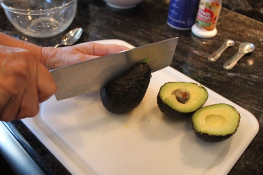 Cutting open the avocado.