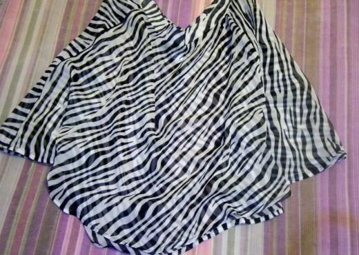 A zebra print dress shawl