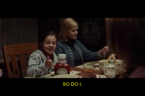 The closed captioning appears in the form of yellow text in the lower-center part of the screen.